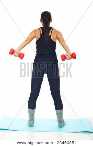 Rear View Of Woman With Barbell