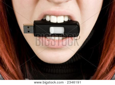 Girl Biting An Usb Flash Drive