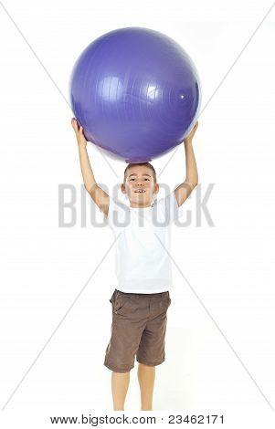 Boy Holding Big Ball Over Head