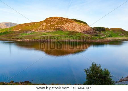 Beautiful Hill Reflected In A Lake