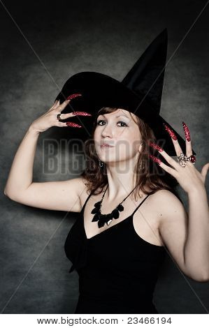 Witch With Long Red Nails