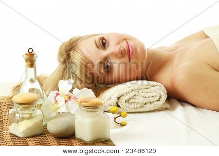 Young woman lying at spa saloon