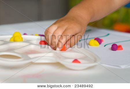 Baby Hand And Plasticine