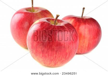 three ripe red apple