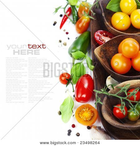 Several varieties of tomatoes and spices over white (with sample text)