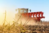 Modern Combine Harvester Works In The Field. Sowing And Harvesting. poster