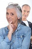 stock photo of jive  - a senior woman hiding something from her husband - JPG