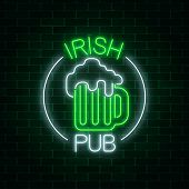 Glowing Neon Irish Pub Signboard In Circle Frame With Text On Dark Brick Wall Background. Luminous A poster