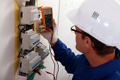 stock photo of fuse-box  - Electrical inspector reading power output - JPG