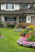 image of lawn chair  - A well maintained residential home with a beautiful perennial and annual garden - JPG