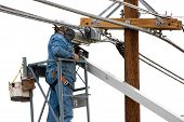 pic of boom-truck  - Utility line worker inspecting and working on utility line