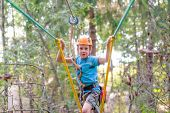 Brave Boy On A Zip Line. The Concept Of The Overcoming Challenge poster