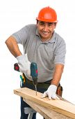 portrait isolated worker using cordless electric drill