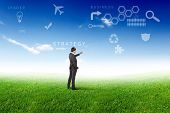 image of business success  - Young businessman outdoor with business symbols on the sky background - JPG