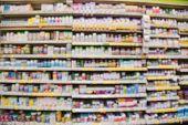 Blurred Vitamin Store Shelves Huge Variation Of Vitamins And Supplements poster