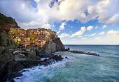 stock photo of beach-house  - Manarola fisherman village in a dramatic windy weather - JPG