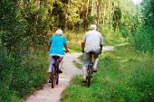 Active Senior Couple Riding Bikes In Nature, Active Retirement poster