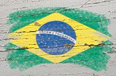 Flag Of Brazil On Grunge Wooden Texture Painted With Chalk