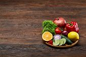 Colorful Still Life Of Fresh Organic Fruits And Vegetables On Wooden Plate Over Rustic Wooden Backgr poster
