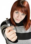 Redhead Girl Holding A Flash Drive At Camera