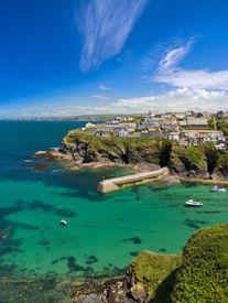 pic of verbs  - Cove and harbour of Port Isaac with blue skies - JPG
