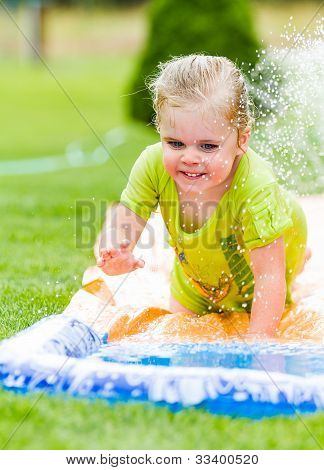Smiling Girl Cooling Off On A Hot Summer Day