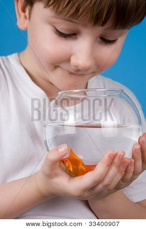 Boy Holds A Fishbowl With A Goldfish