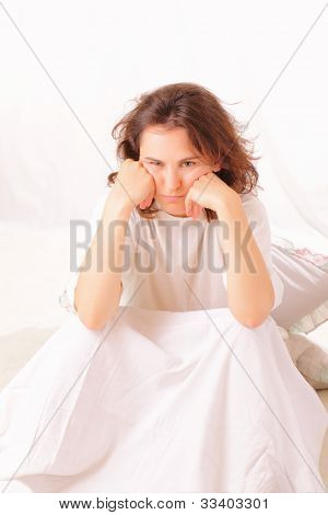 Angry Young Woman Sitting In Bed