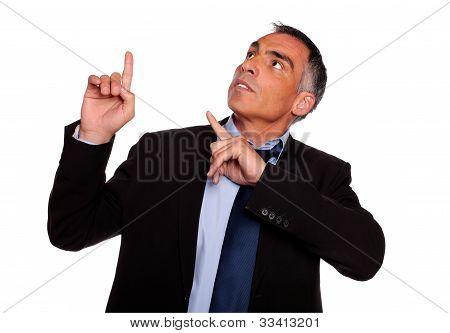 Hispanic Senior Businessman Pointing Up
