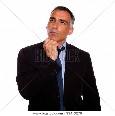 Peaceful And Reflective Man Touching The Chin