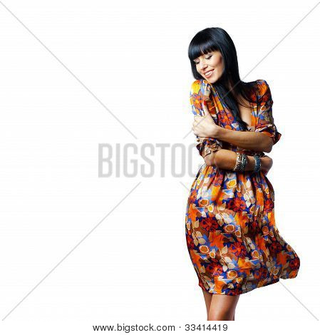 Portrait Of A Stylish Confident Woman Standing With Arms Crossed Isolated On White Background