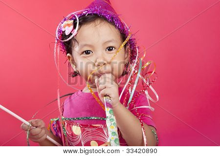 Cute Girl Blowing Party Horn