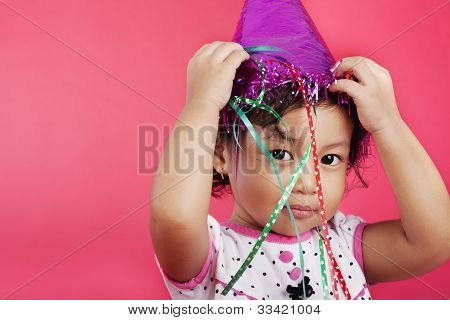 Cute Girl Wearing A Party Cap