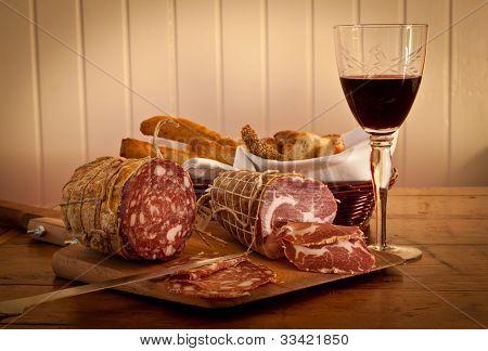 A Glass Of Wine With Home-made Bread And Salami