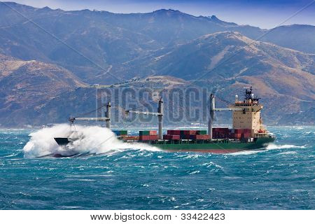 Loaded container freight ship in stormy sea