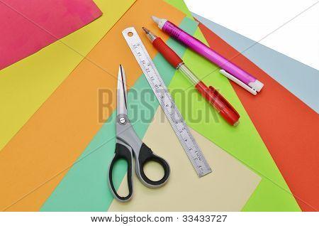 Closeup Of Papers, Ruler, Scissors, Pencil And Eraser