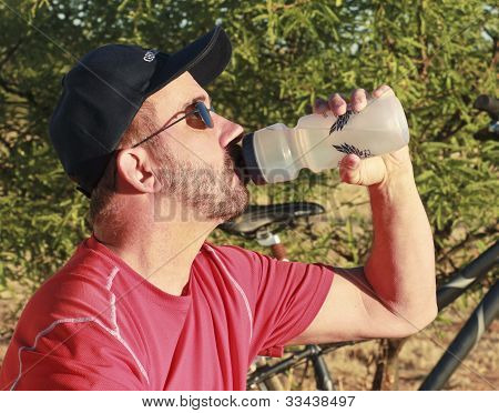 A Bicyclist Stops For A Water Break