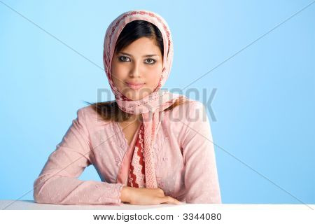 Young Muslim Woman In Traditional Wear And Head Scarf