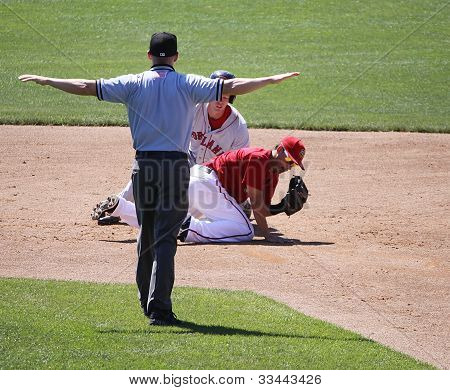 he umpire signals safe fora  Portland Seadogs' runner at second base