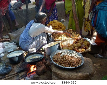 Tribal Woman Sells Freshly Made Snacks