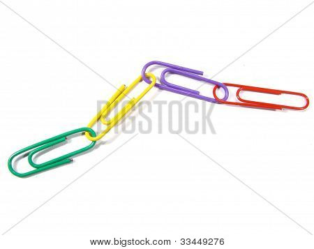 Aligned and connected paperclips isolated in white