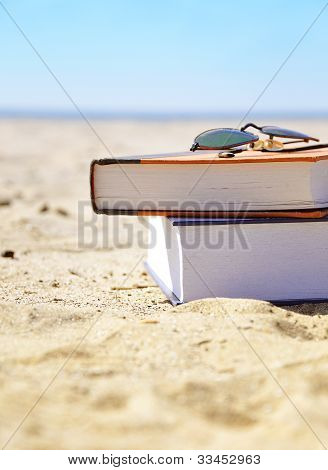 Vacation Beach with Books in Sand