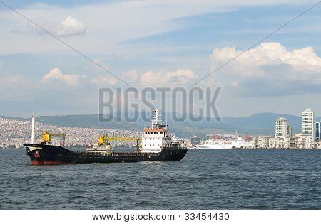 Cargo Ship On Izmir Background