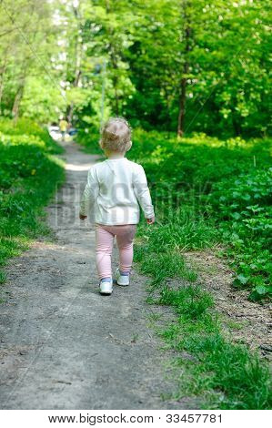 Little Girl Walking In Forest