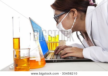 Lab Assistant Works With Laptop