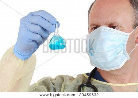 Doctor examining blue laboratory sample