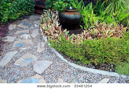 home garden with fountain jar