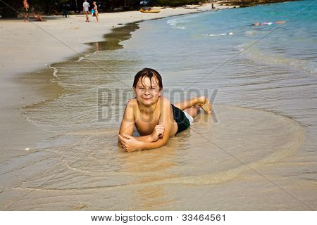 Happy Young Boy Enjoys The Beach