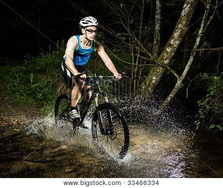 cyclist driving through water