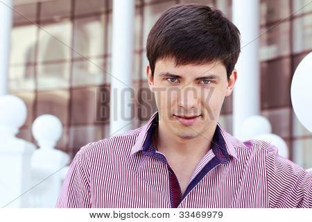 Handsome Man On Office Building Background